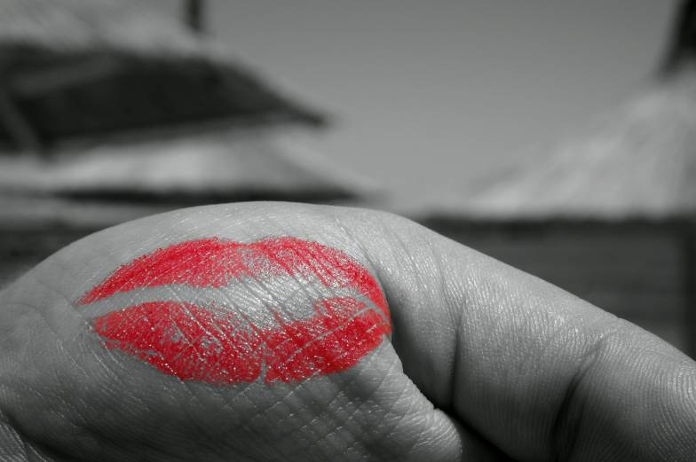 red lips hand kiss